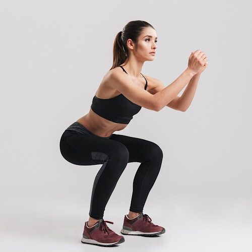 Woman doing squats.