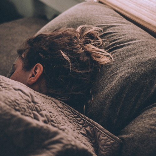 A woman sleeping comfortably.