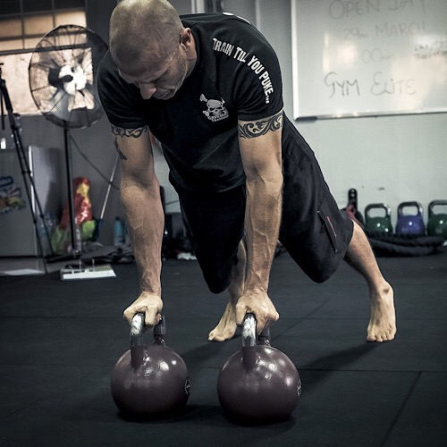 A man doing a kettlebell workout.
