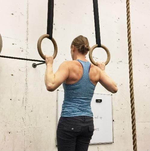 Woman doing pull-ups.