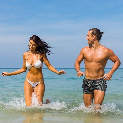 Couple enjoying the beach together.