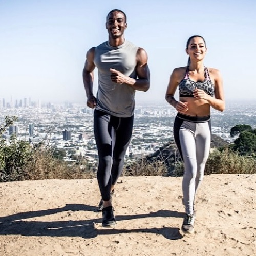 Man and woman doing a running exercise together.
