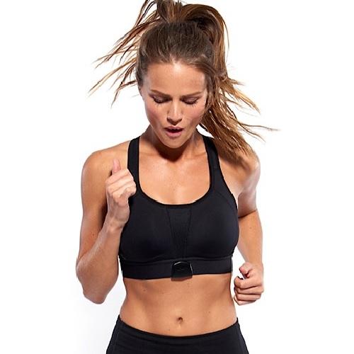 A woman wearing a shefit bra while running.