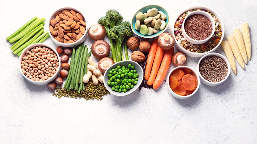 Food sources of plant based protein. Healthy diet with legumes, dried fruit, seeds, nuts and vegetables. Foods high in protein, antioxidants, vitamins and fiber. Image with copy space. Top view - Image