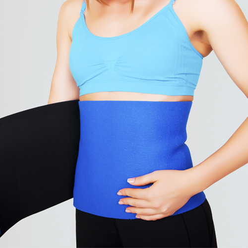 A woman wearing a waist trimmer.