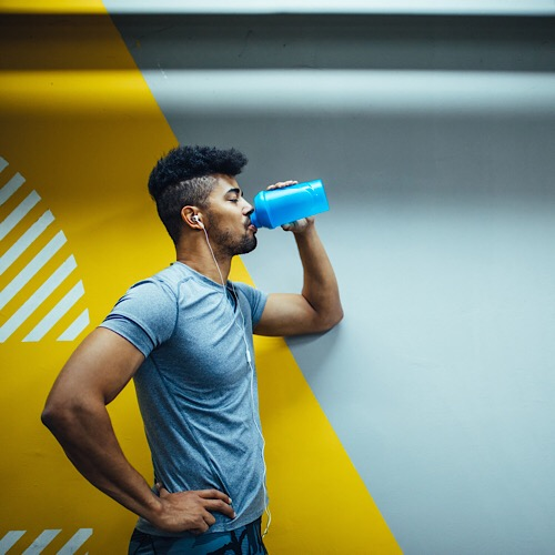 Young african american man drinking a water. - Image