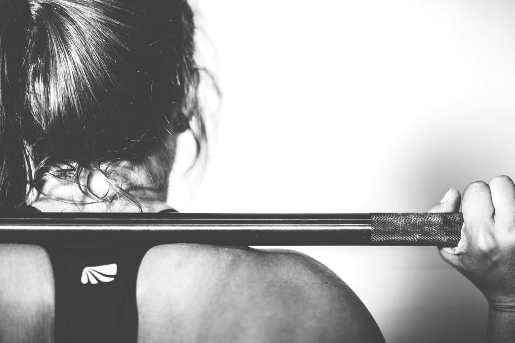 This well-toned woman lifting weights probably gets enough protein