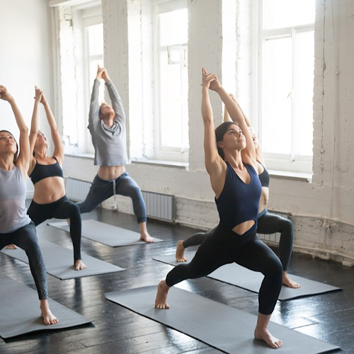 A diverse people doing yoga.