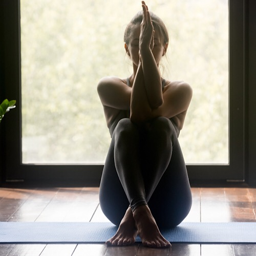 A woman doing a yoga pose.