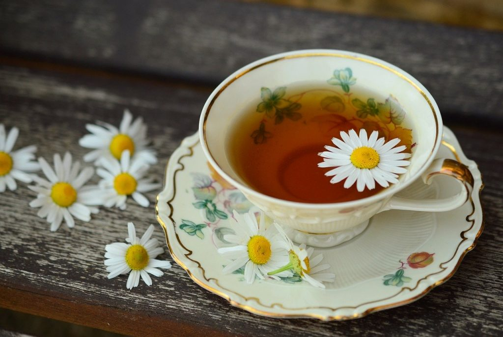 A close up of a cup of chamomile tea.
