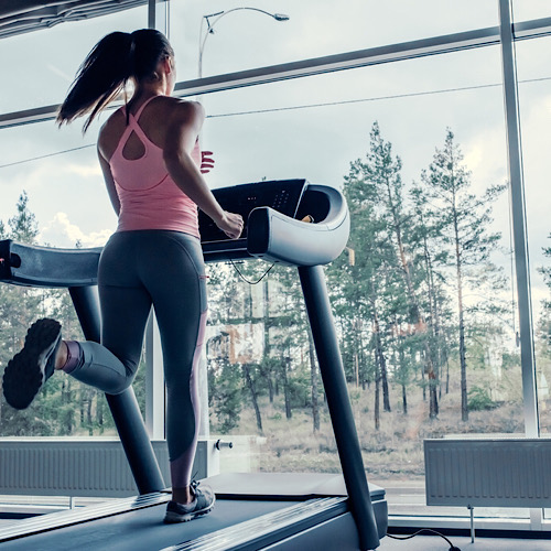 Fit woman running on a treadmill.