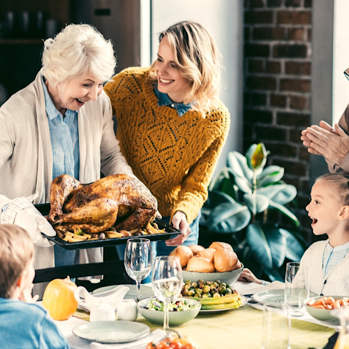A family celebrating the holidays with a roasted turkey.