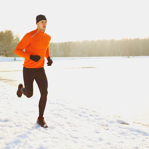 A man jogging on a snow.