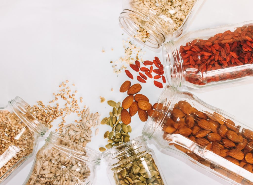 Jars of nuts and seeds that you can add on your homemade protein bars.