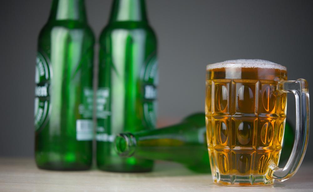 Bottles of Heineken Light, and a beer mug.