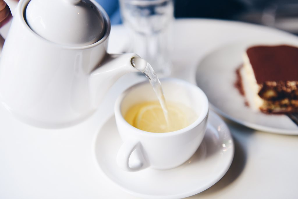 Pouring a lemon tea in a cup.