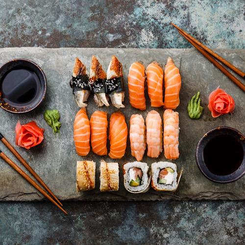 Sushi set. Sashimi Rolls served on a stone tray.