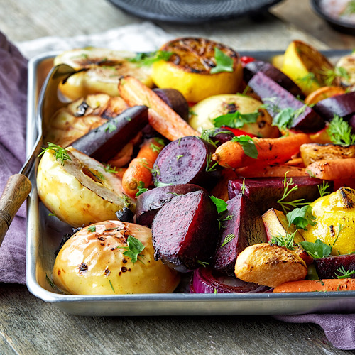 Roasted vegetables in a baking pan.