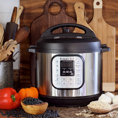 Instant pot for crock-pot meals, bell pepper and kitchen utensils.