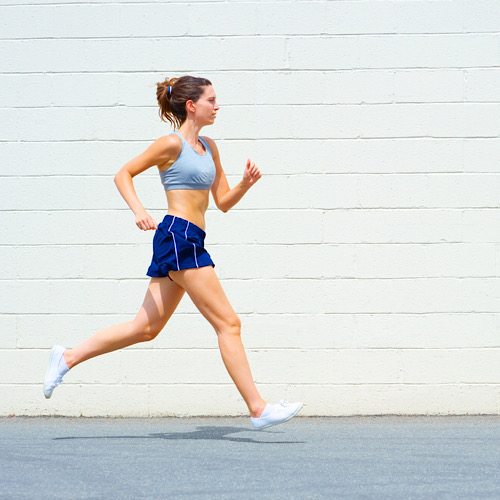 A woman running for cardio exercise.