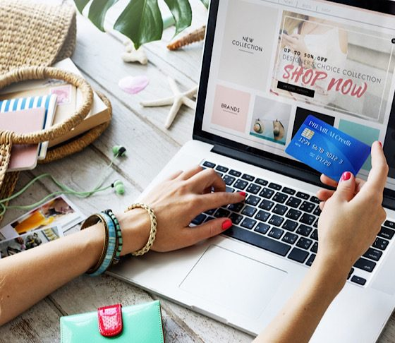 Woman using credit card for online shopping.