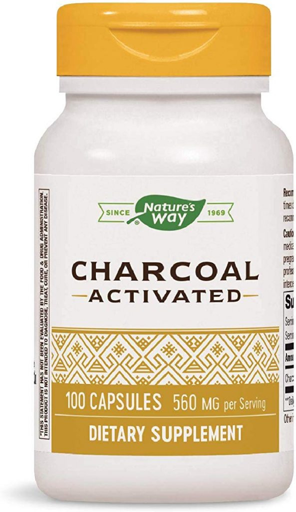 A bottle of activated charcoal, often advertised as a home remedy for bloating