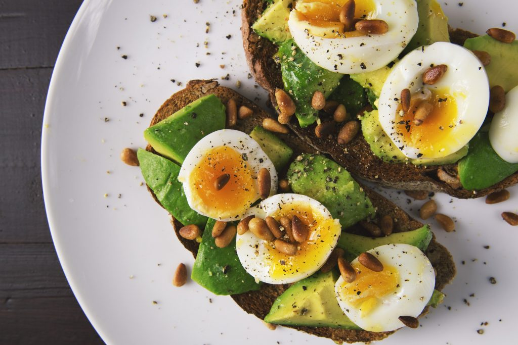 Close up of Egg and Avocado on a plate.