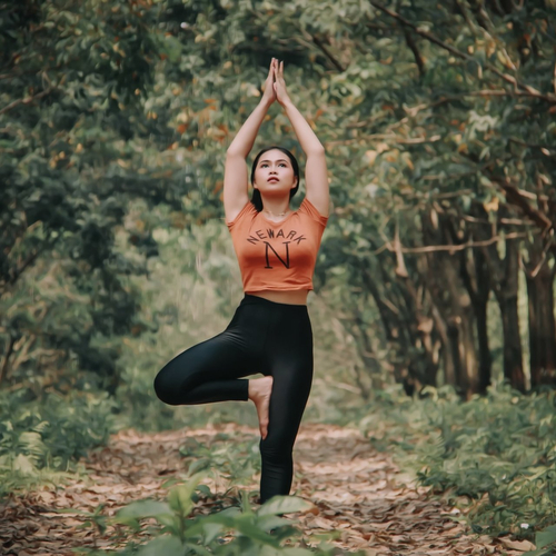 A woman doing a yoga outdoors.