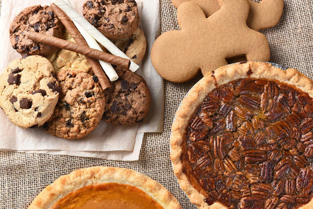 Close up of cookies and pie on a table.