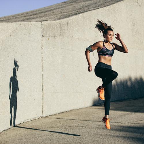 A woman doing a knee-high jumping.