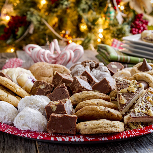 A platter of desserts and sugary pastries.
