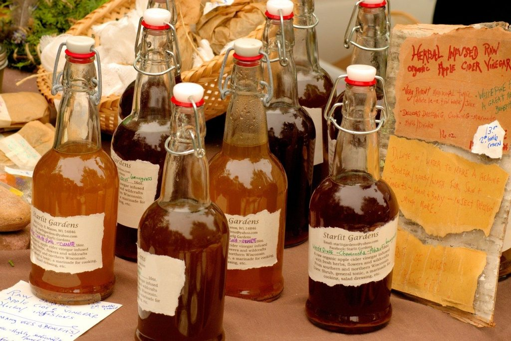 Several bottles of raw organic apple cider vinegar. Are you aware of apple cider vinegar benefits?