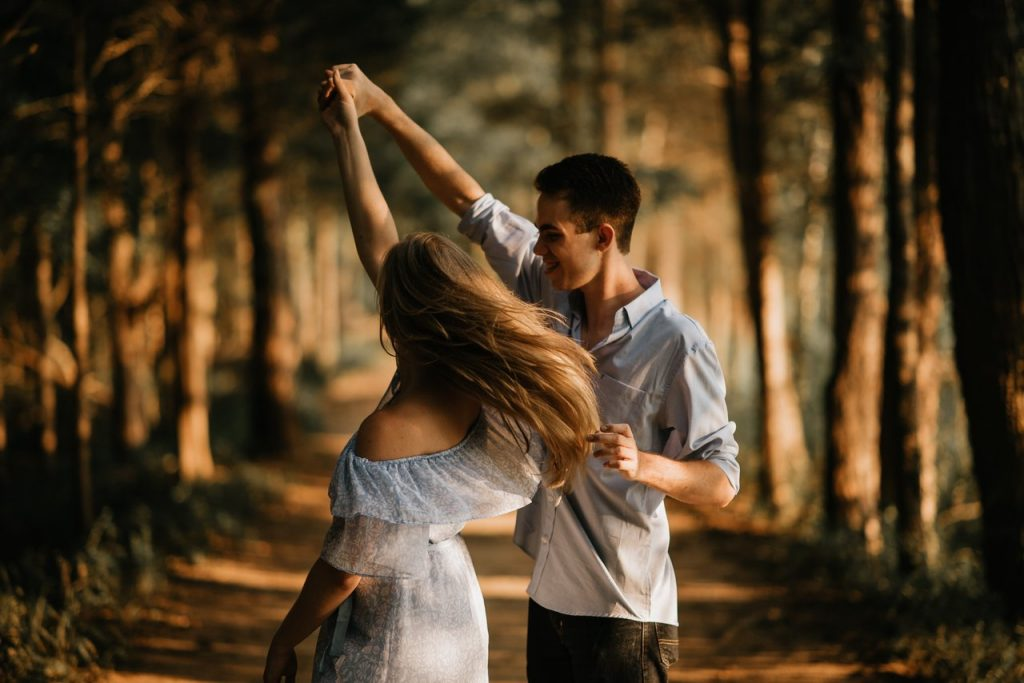 Couple dancing in the woods as an exercise to reduce anxiety