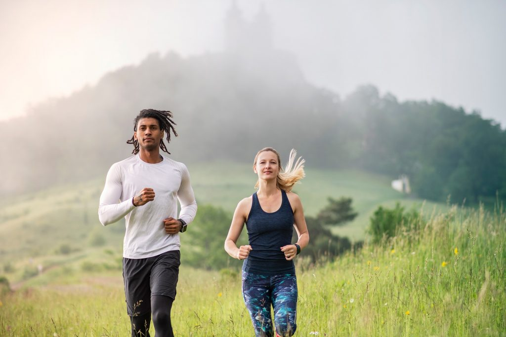 A man and a woman doing cardio wearing eco-friendly clothes.