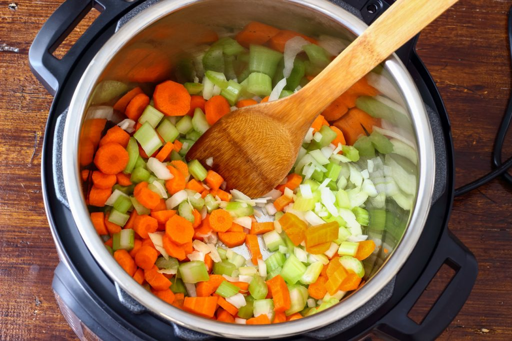 Vegetables being cooked in an instant pot, following vegetarian instant pot recipes.