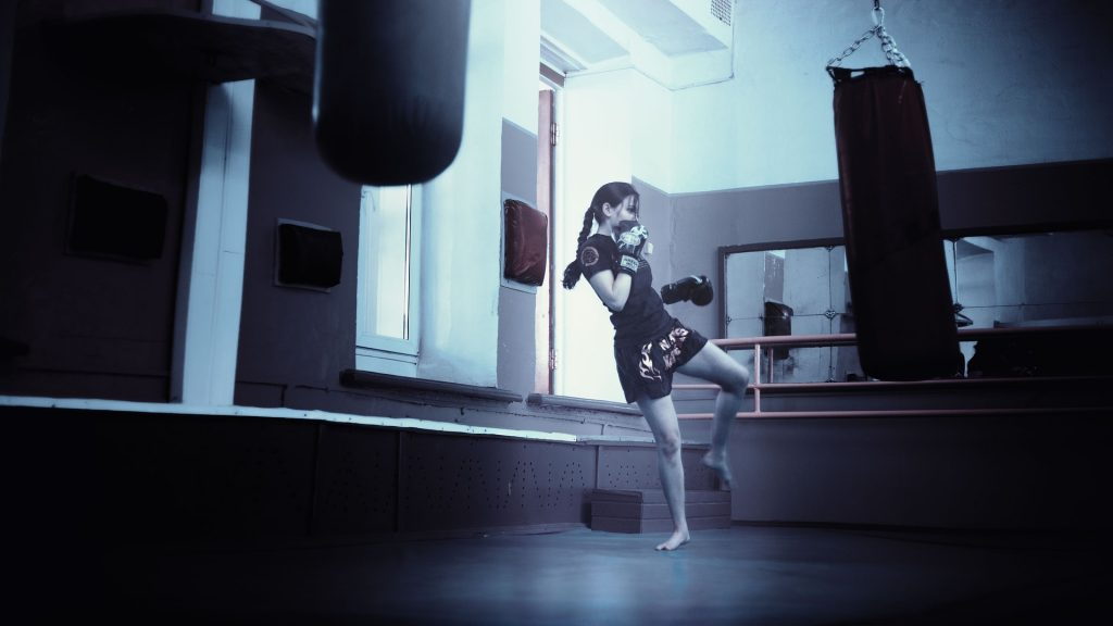 A woman doing kickboxing as a fun cardio workout