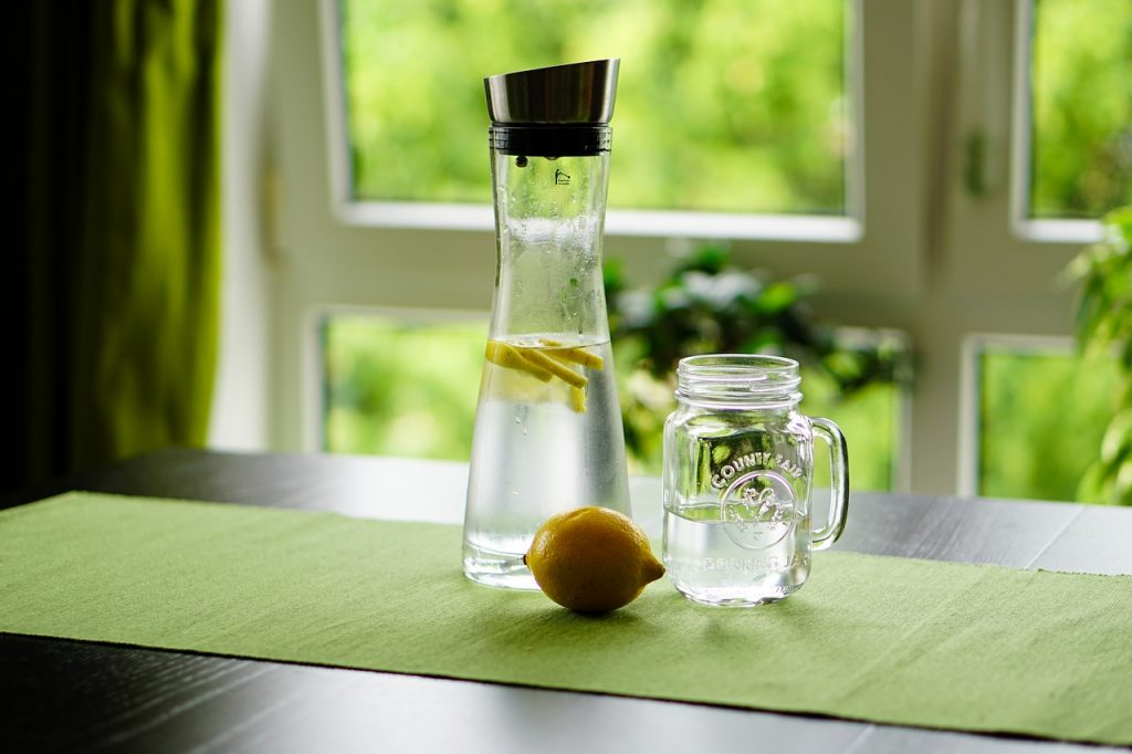 A pitcher of lemon water. Lemon water as one of the natural fat burning supplements.