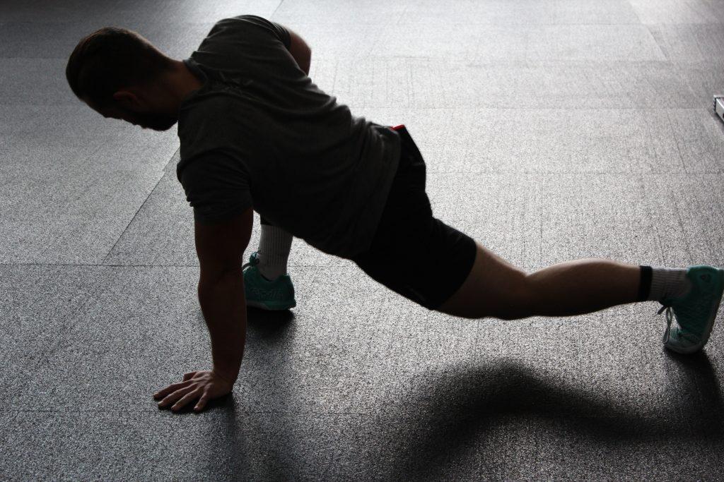 Man stretching legs.
