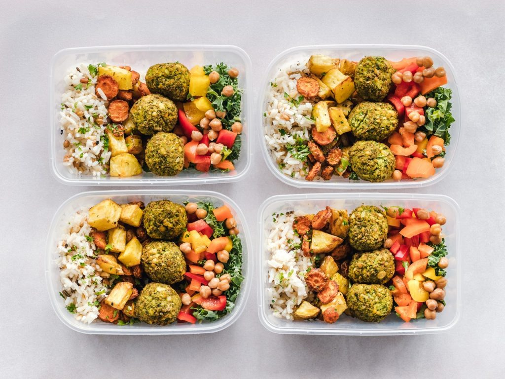 Packed meals in plastic food storage containers. Bringing your own food when you travel is one of the travel strategies for staying on track. Plus , it is healthier than snacking on some chips and other junk food.