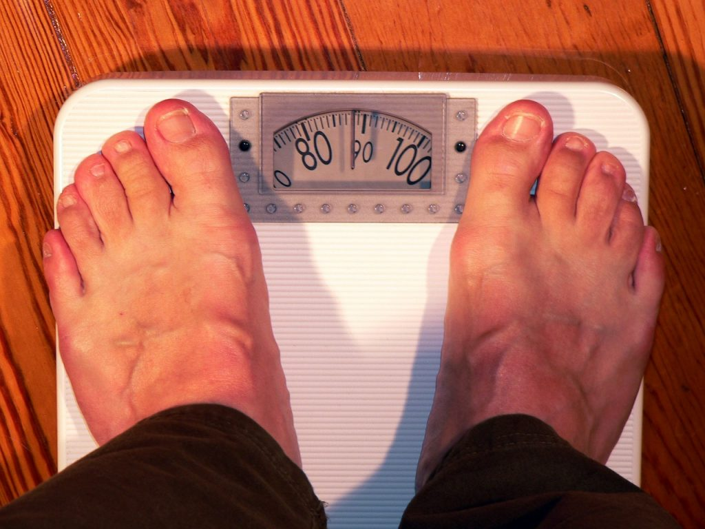 Person weighing on a bathroom scale.