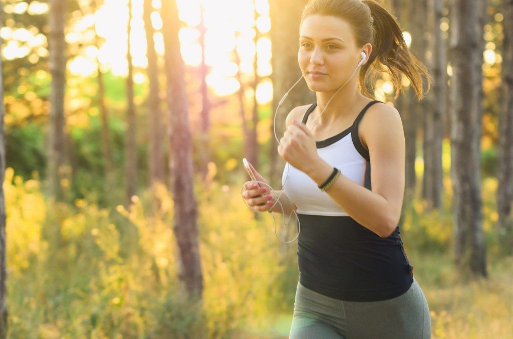 Fit woman running, to boost her mood. Which proves that exercise reduce anxiety.