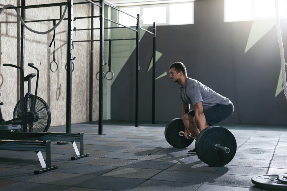 Man doing deadlift as part of his strength training exercise
