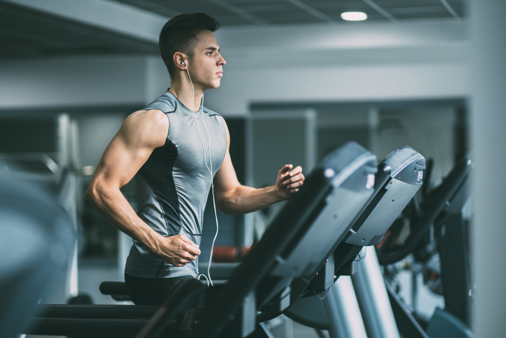 Man running on treadmill is one of the best cardio exercises.