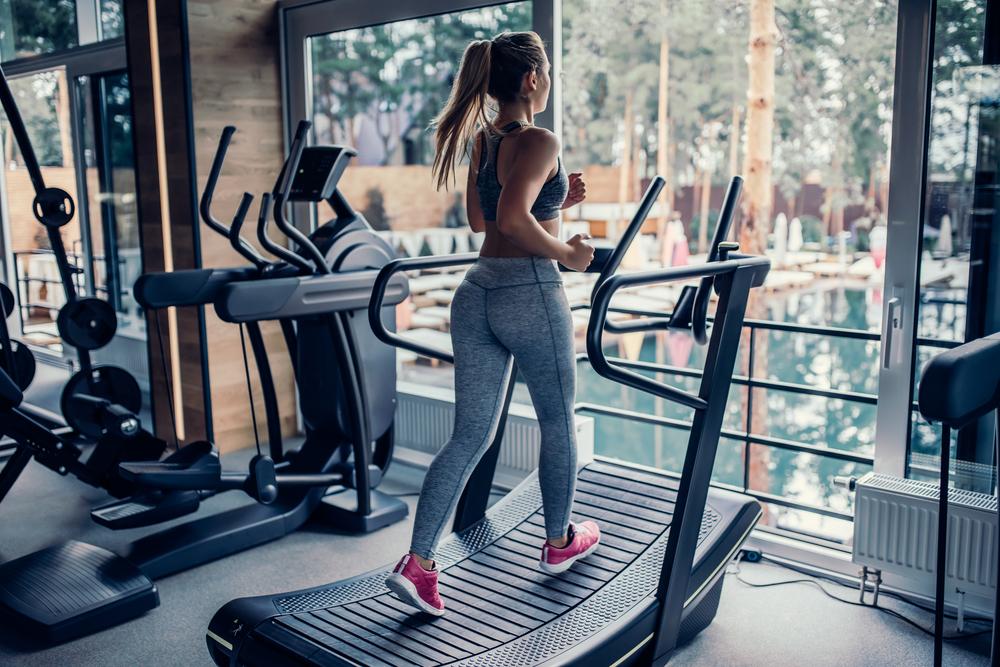 Woman jogging on treadmill.