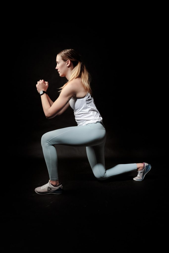 Woman doing lunges indoors as part of her home hiit workouts.