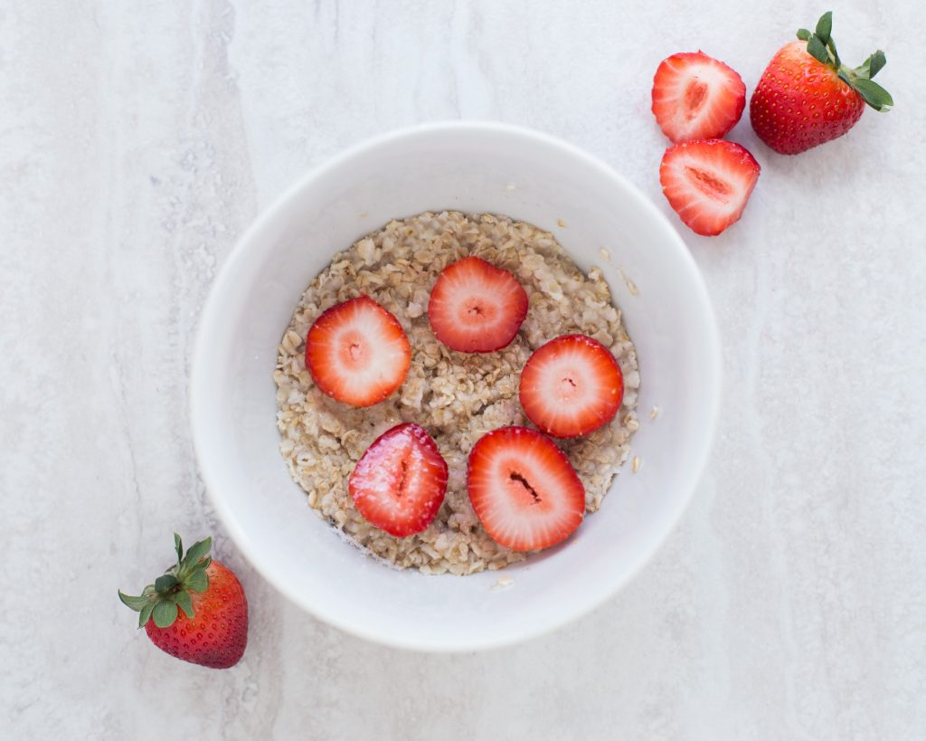 Oatmeal with strawberries in a bowl.