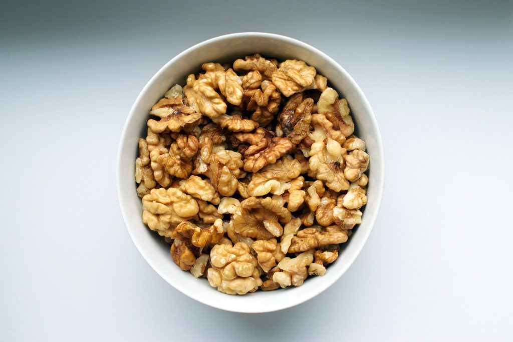 A bowl of walnuts as an alternative to avoid eating hidden sugar in foods and other snacks.