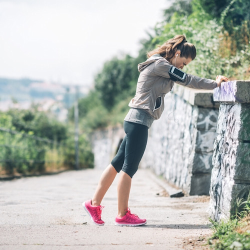 Woman taking a break from running.