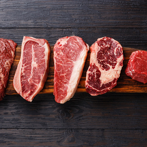 Variety of Raw Black Angus Prime meat steaks