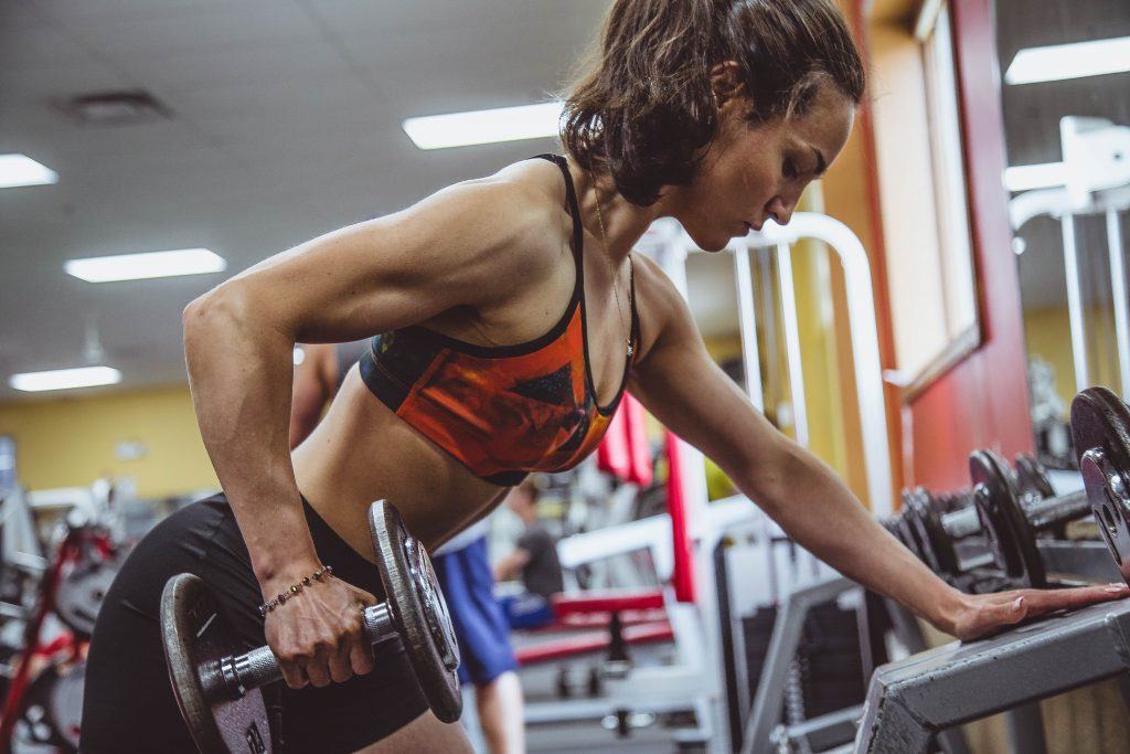 Fit woman lifting weights at the gym.